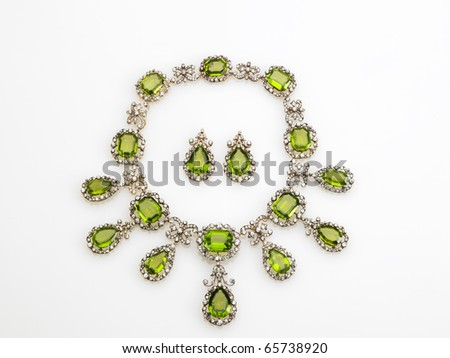 emerald and diamond jewelry isolated on white - stock photo