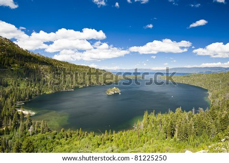 Emerald Bay with beautiful cloudy sky and green tree in the foreground, South Lake Tahoe, California, USA - stock photo