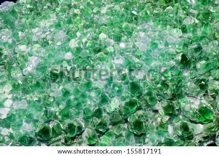 Emerald Green Amethyst Cluster Background - stock photo