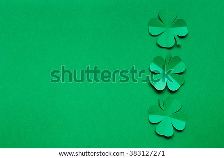 Emerald green paper clover shamrock leafs border frame on background. St. Patrick's Day postcard template. Space for copy, lettering, text. - stock photo