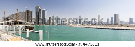 emerald lagoon and view of city in united emirates