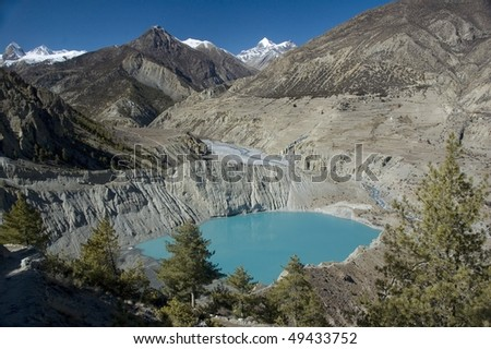 Emerald lake in  Annapurna Conservation Area. Nepal - stock photo