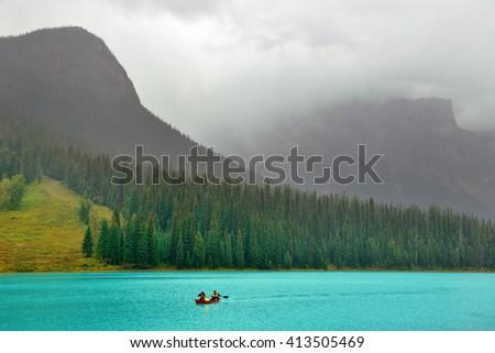 Emerald lake with fog in Yoho National Park, Canada. - stock photo