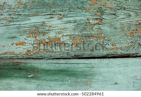 emerald shade coloured cracked paint peeling on wood texture