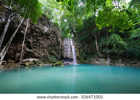 Emerald Waterfall in Deep Forest