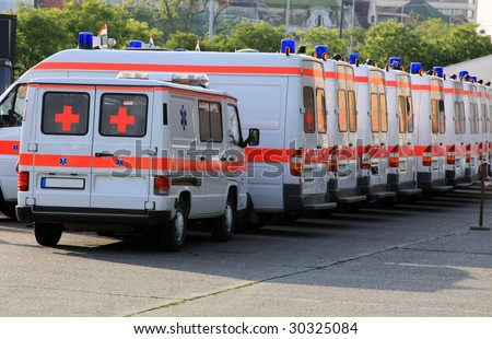 Emergency ambulances in the row - stock photo