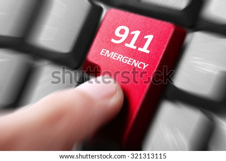 Emergency 911 button. gesture of finger pressing emergency 911 button on a computer keyboard - stock photo