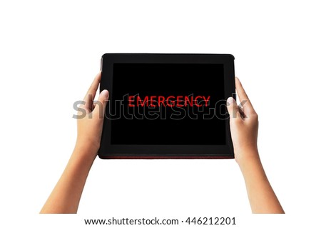 "Emergency Concept.  "" EMERGENCY  "" words in red  color on tabled in boy hands on black background."