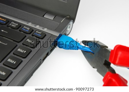 emergency disconnect ethernet plug on a notebook - stock photo