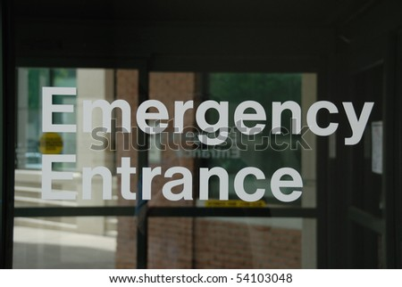 Emergency Entrance sign on sliding glass door. - stock photo