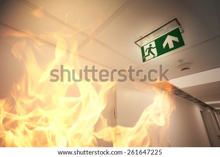 Emergency exit and fire alarm - stock photo