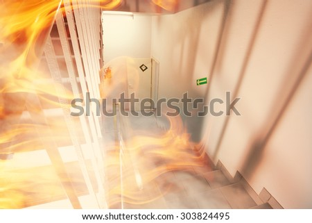 Emergency exit and fire in the building - stock photo