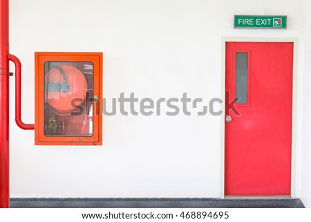 Emergency exit door, fire exit sign and fire hose cabinet.
