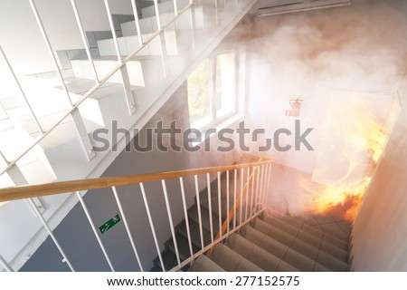 Emergency exit - fire in the building - stock photo