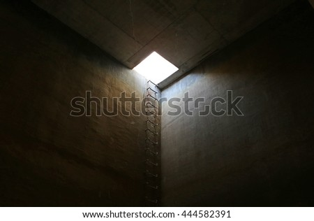 Emergency exit of underground tank - stock photo