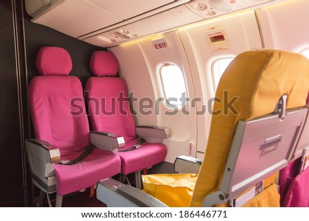 Emergency exit on an aircraft, view from inside of the plane - stock photo