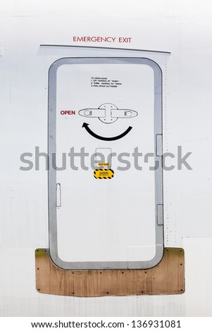 Emergency exit on an aircraft, view from outside of the plane - stock photo