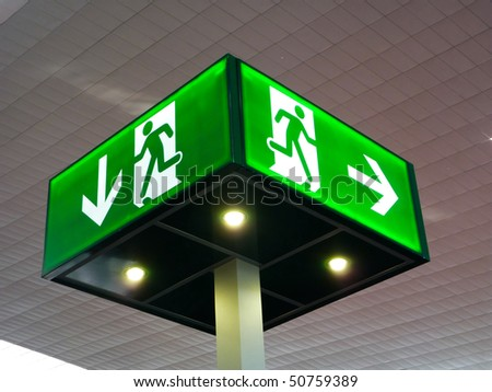 Emergency exit sign, cube light on ceiling, concept - stock photo