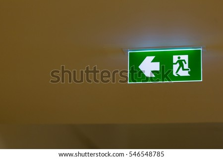 Emergency exit sign in modern offices inside an industrial plant.