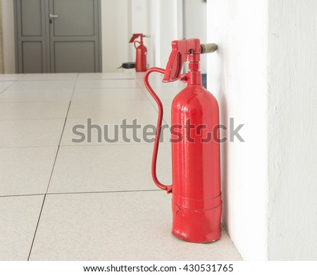 Emergency exit with fire extinguisher - stock photo
