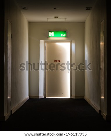 emergency fire exit outlet sign and door - stock photo