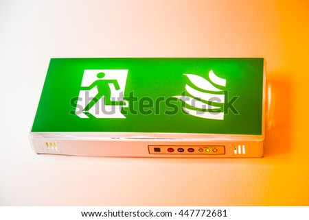 Emergency Fire exit with man escape icon sign in office building. - stock photo
