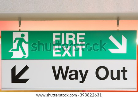 Emergency fire signboard and way out - stock photo
