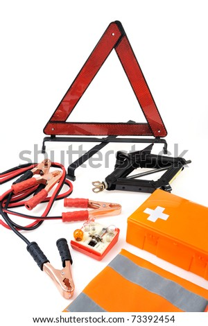 Emergency kit for car - first aid kit, car jack, jumper cables, warning triangle, light bulb kit - stock photo