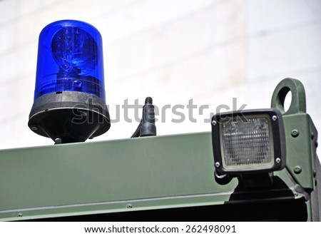 Emergency light and siren of the military ambulance - stock photo