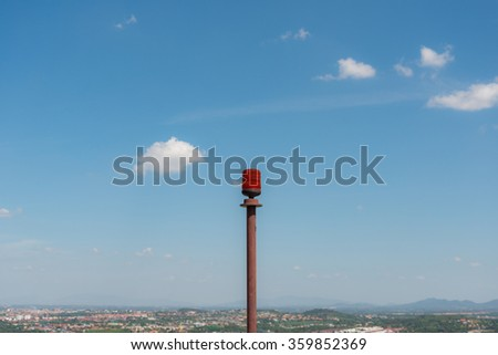Emergency light set on high and the city below - is intended to alert the emergency. - stock photo
