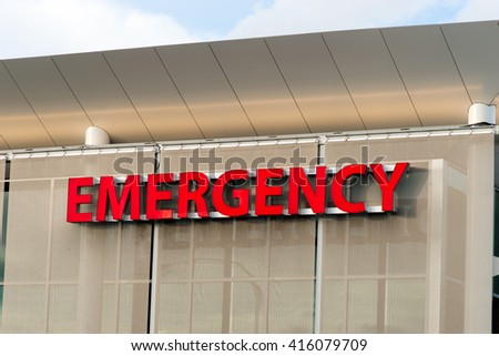 Emergency Medical Center Building Sign Health Care Hospital - stock photo