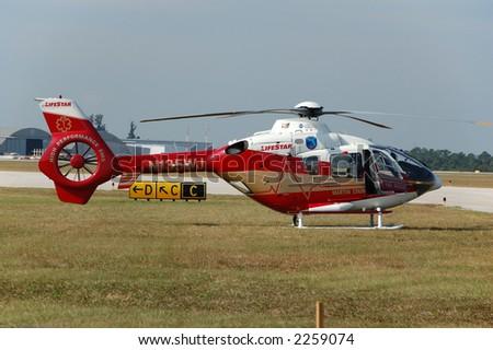 Emergency medical evacuation helicopter - stock photo