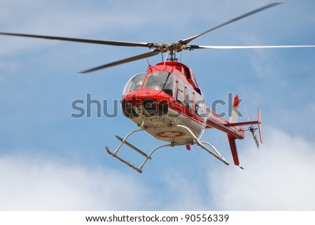 Emergency Medical Helicopter in flight - stock photo
