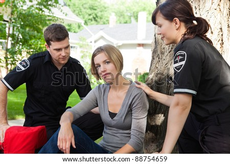 Emergency medical team with recovering patient - stock photo