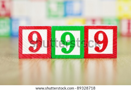 Emergency Number 999 in Child's Building Blocks