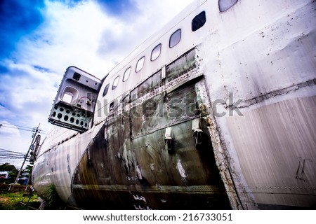 Emergency old aircraft,Abandoned Airplane,old crashed plane with cloudy sky,plane wreck tourist attraction,Old plane wreck - stock photo