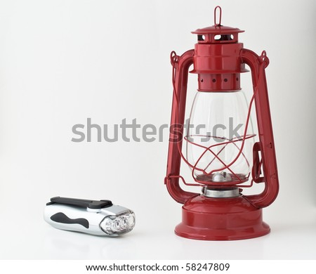 Emergency or power outage kit: kerosene lantern and a flashlight - stock photo