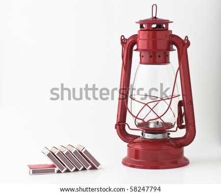 Emergency or power outage kit: kerosene lantern and matches - stock photo