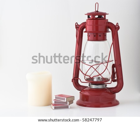 Emergency or power outage kit: kerosene lantern, matches and candle - stock photo