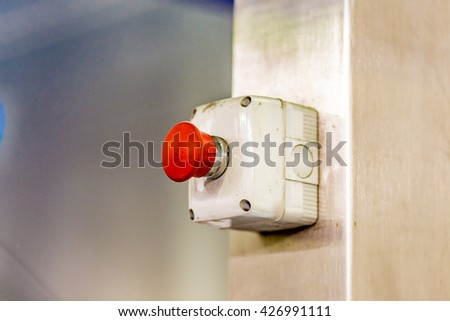 emergency red button for the immediate stop of a machine - stock photo
