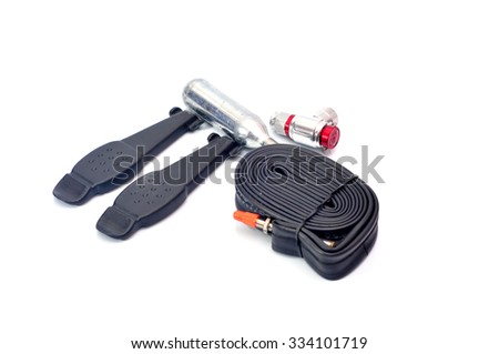 Emergency repair kits (bicycle pump, gas, CO2, tube, tyre leveller) isolated on white background