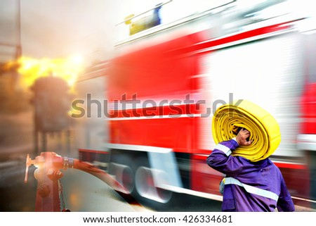 Emergency rescue concept ,Fire fighter on oil and gas industry, successful firefighter at work , Fire suit for fighter with fire and suit for protect fire fighter, Security team when fire case. - stock photo