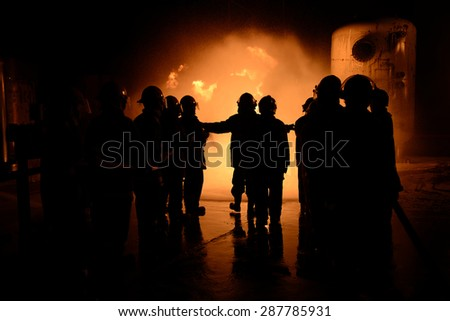 Emergency rescue team for firefighter night industry. - stock photo