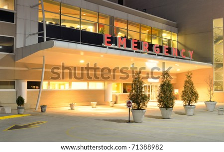 Emergency Room entrance at a hospital at night. - stock photo