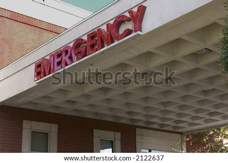 """Emergency Room entrance with large """"Emergency"""" sign on overhang - stock photo"""
