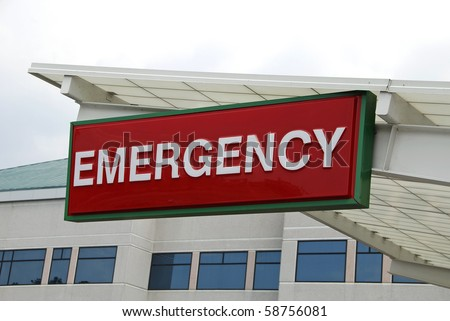 Emergency Sign over a Hospital Emergency Room Entrance - stock photo
