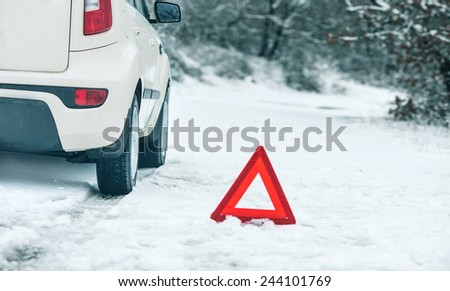 Emergency stop car on winter road in the countryside. - stock photo