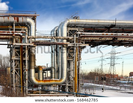 emergency winter heating main against the sky - stock photo