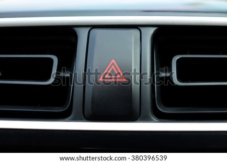 emergent of a warning button in a car - stock photo