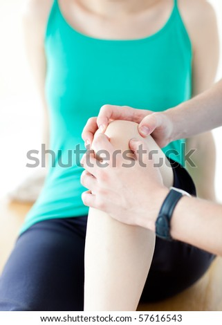 Emerging man doing fitness exercises with a woman in gym - stock photo